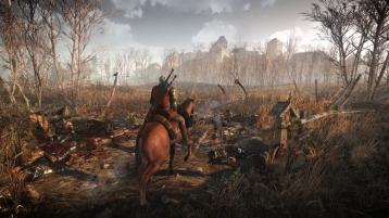 The_Witcher_3_Wild_Hunt_Geralt_travels_through_war_ravaged_territory